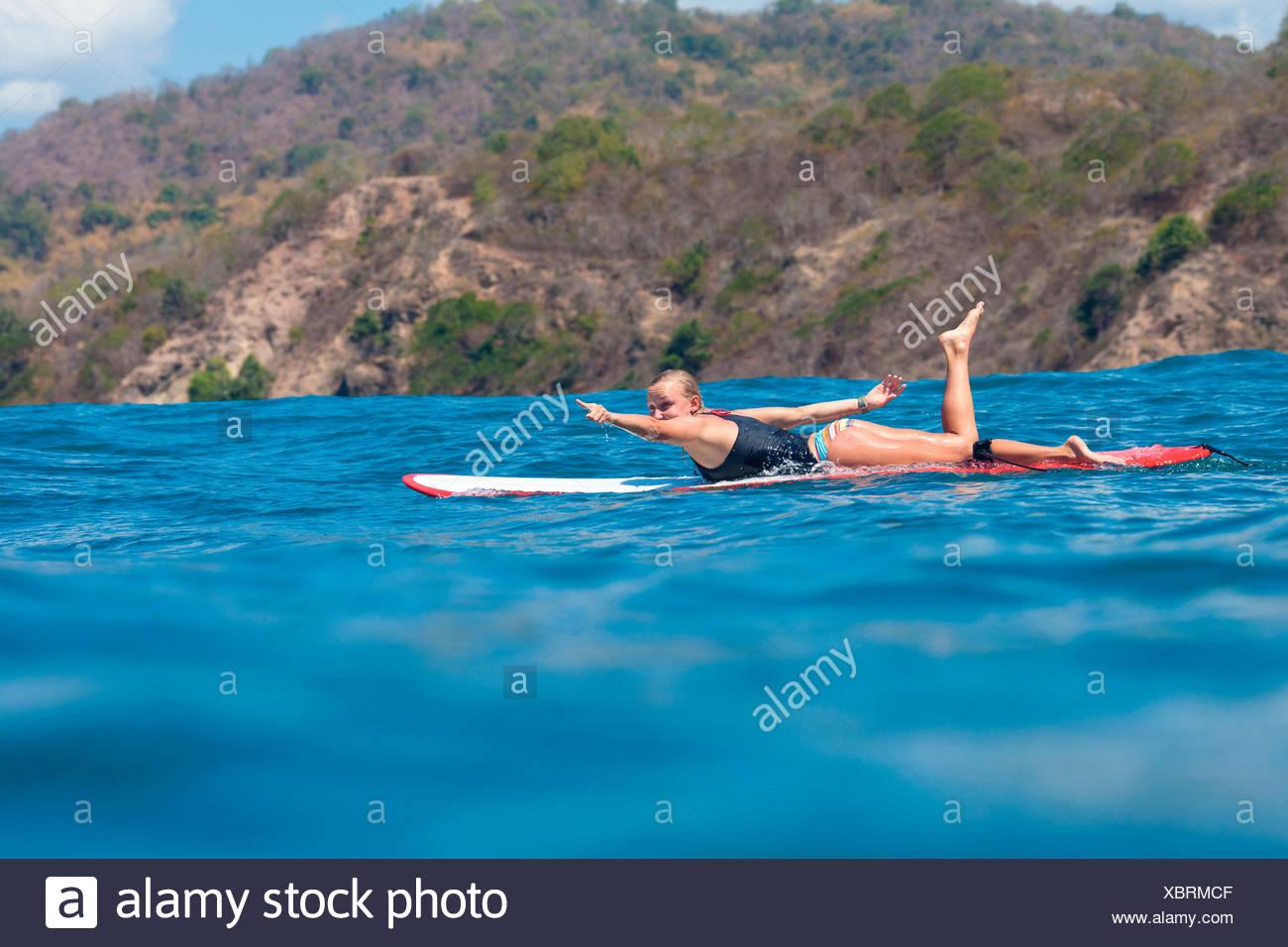 Surfer girl - Stock Image