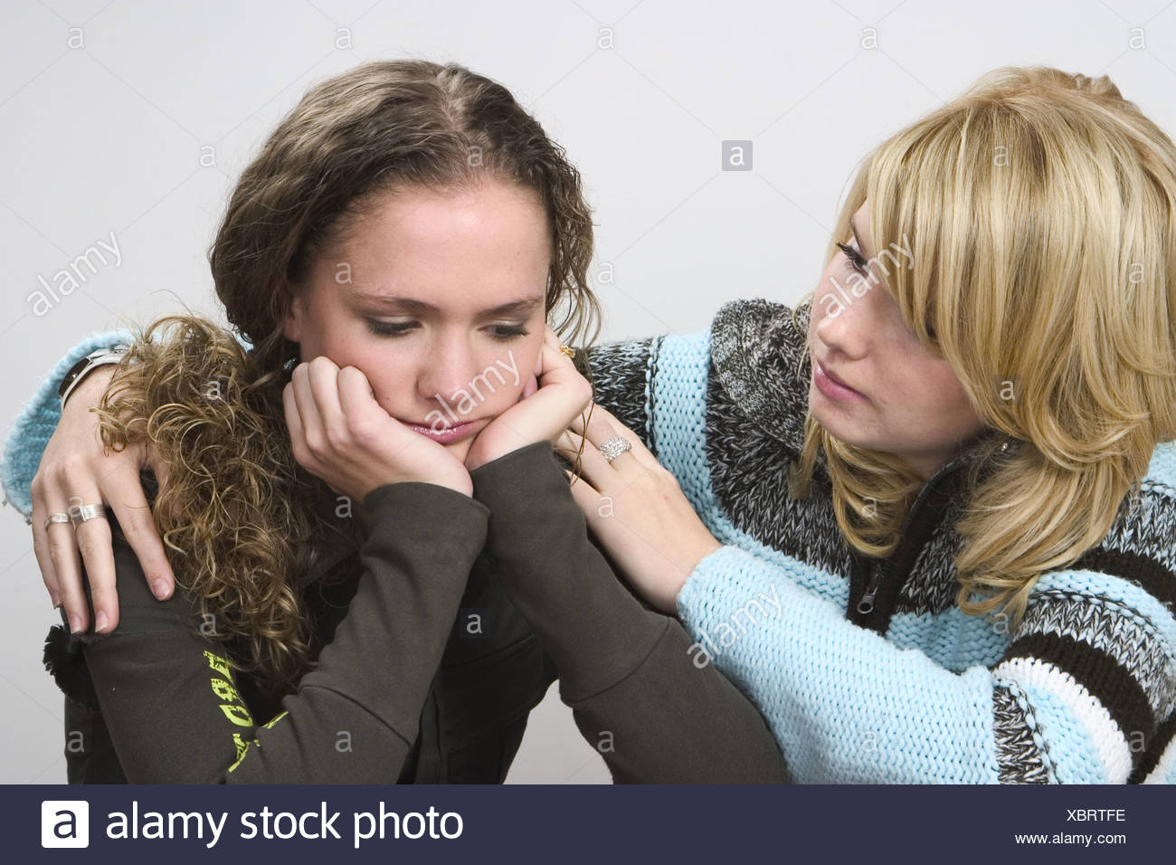 Friends soothing each other - Stock Image