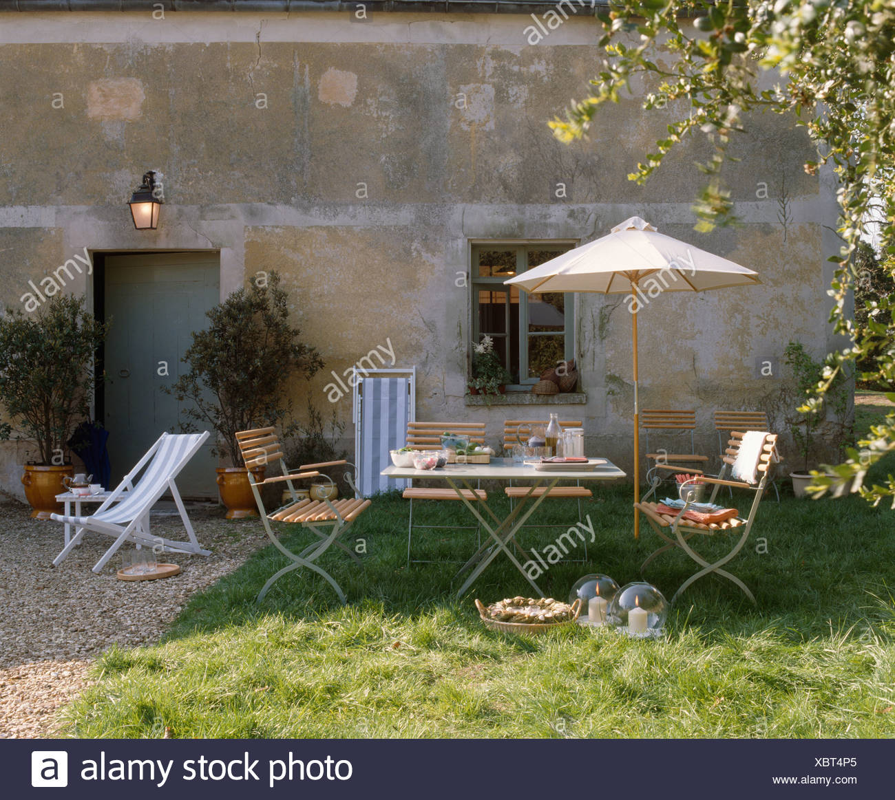 Traditional Garden Furniture Parasol over wooden garden furniture outside traditional french parasol over wooden garden furniture outside traditional french country house workwithnaturefo
