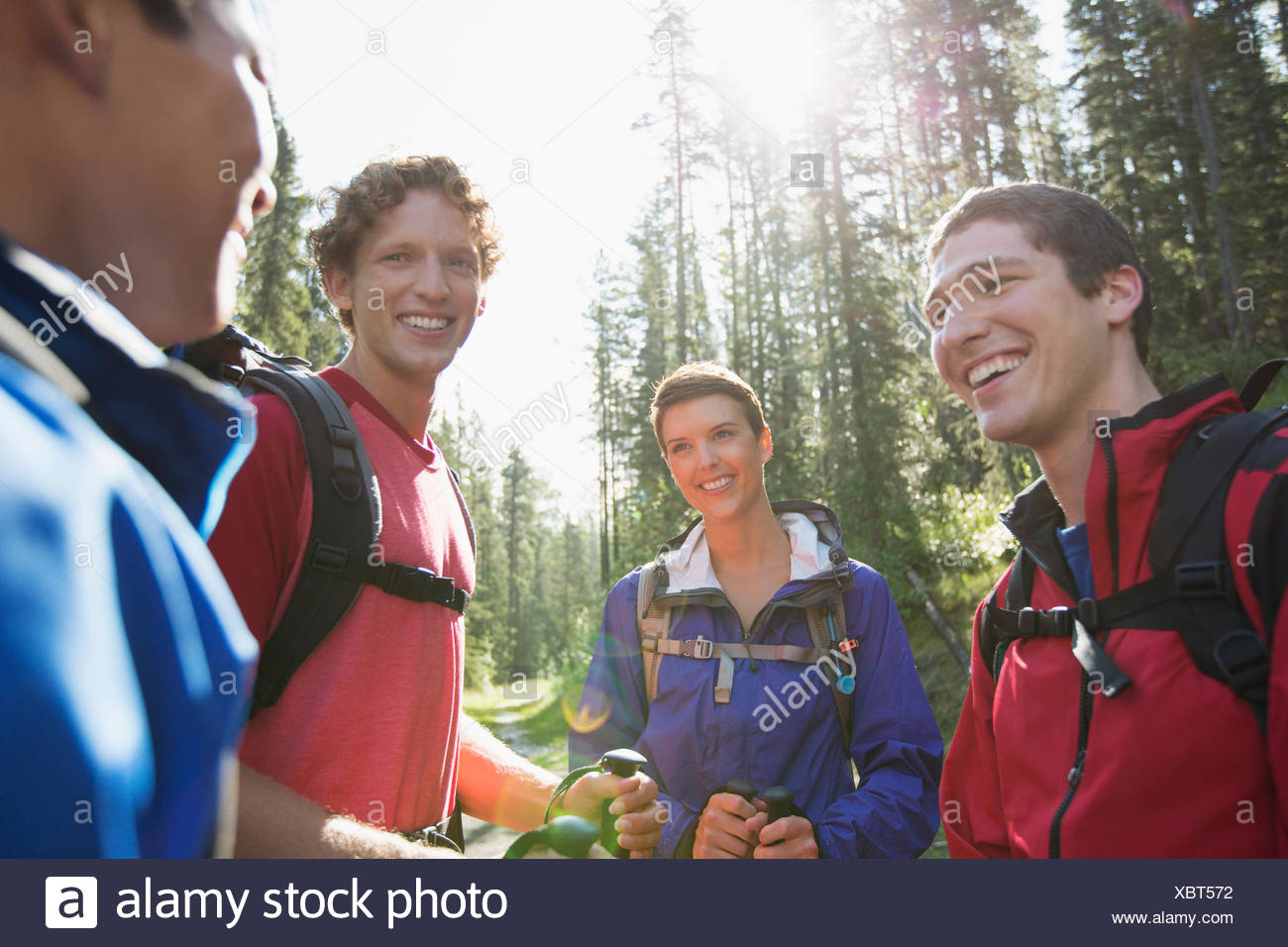 backpackers pausing for conversation on their hike - Stock Image