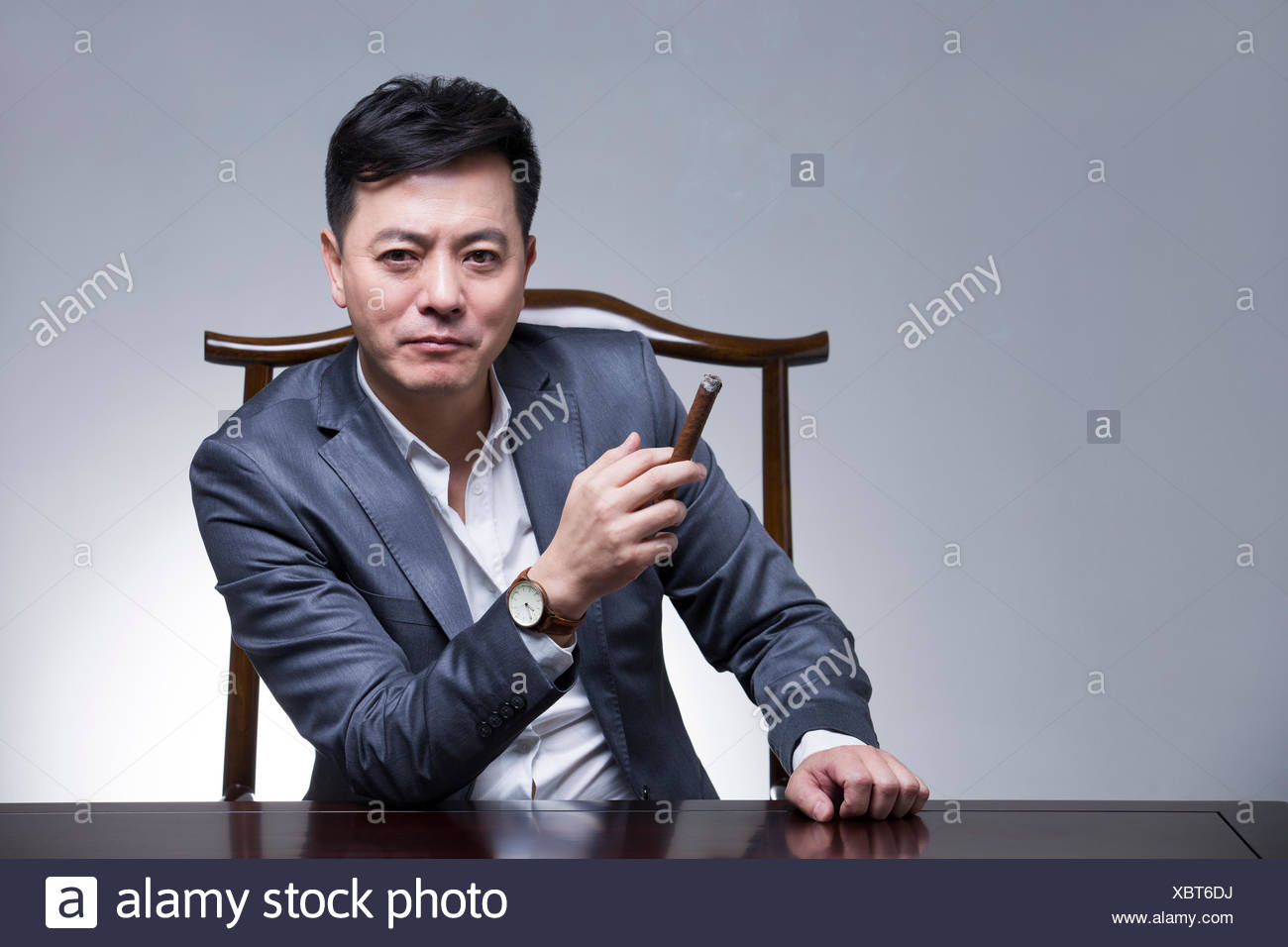 Mature businessman with cigar Stock Photo