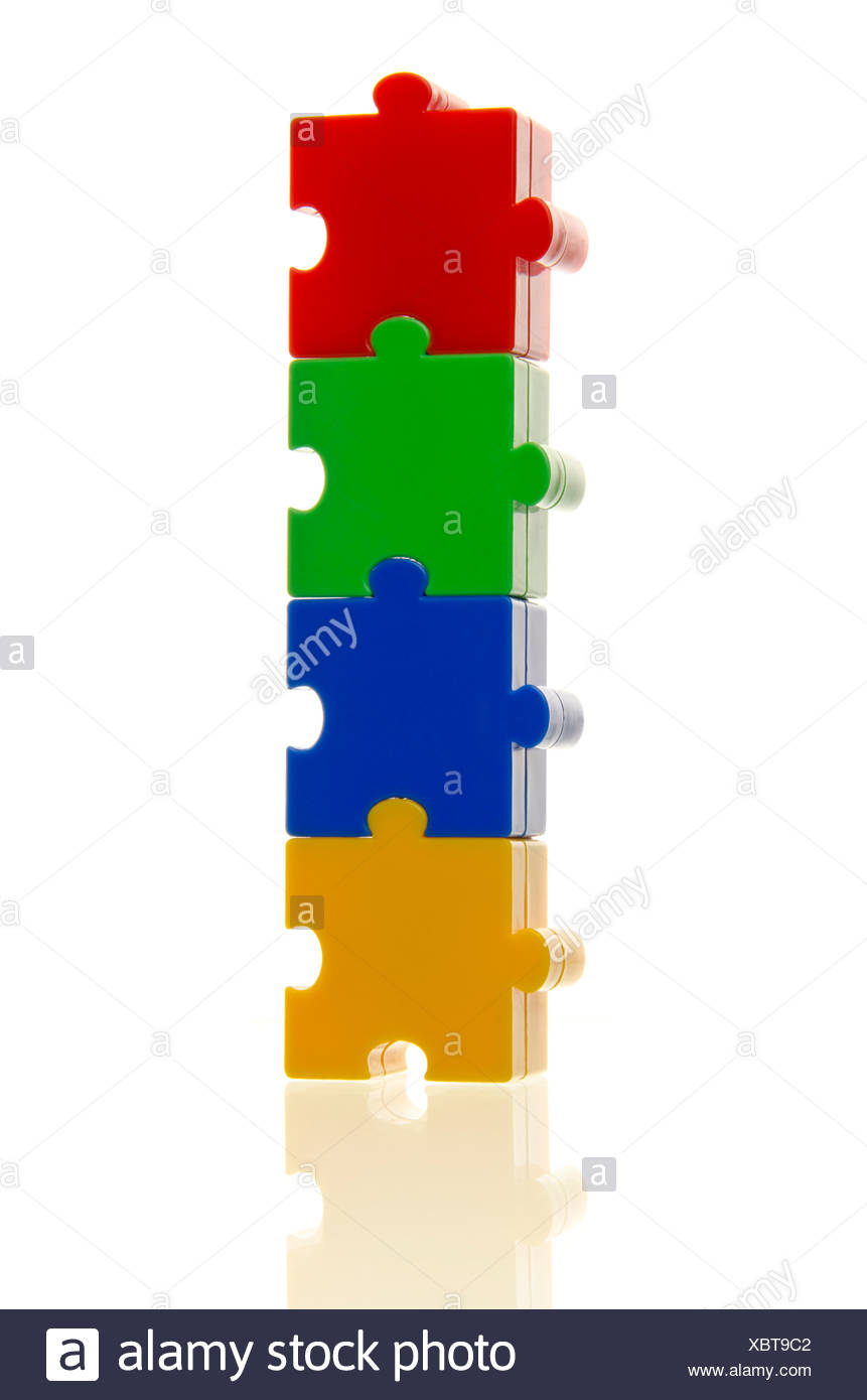 Four colourful puzzle pieces stuck on top of each other, connected, symbolic image for cohesion Stock Photo