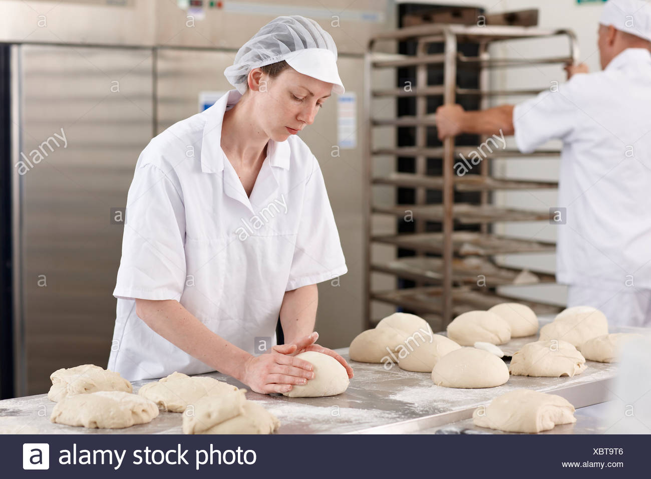 Chef baking in kitchen - Stock Image