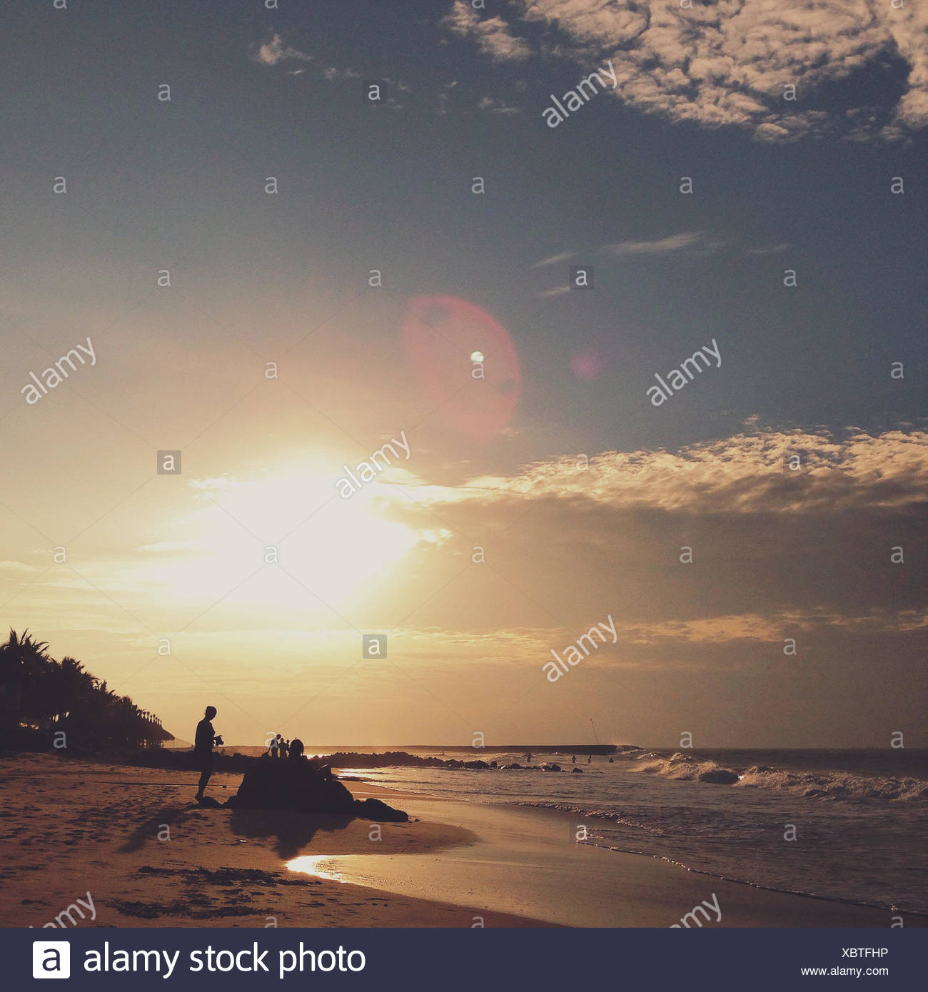 Hanging out on the beach - Stock Image
