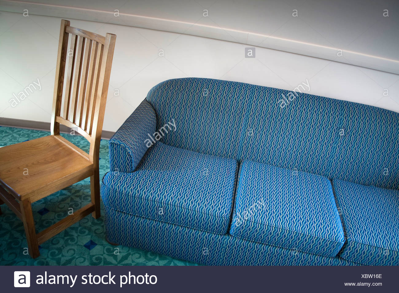 Sofa and chair in a college lounge & Sofa and chair in a college lounge Stock Photo: 282676870 - Alamy