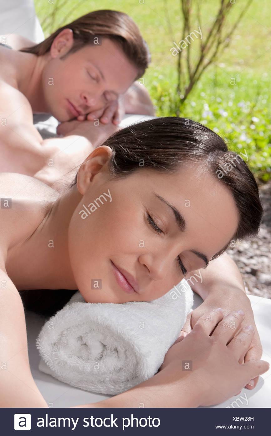 Couple lying on massage tables - Stock Image