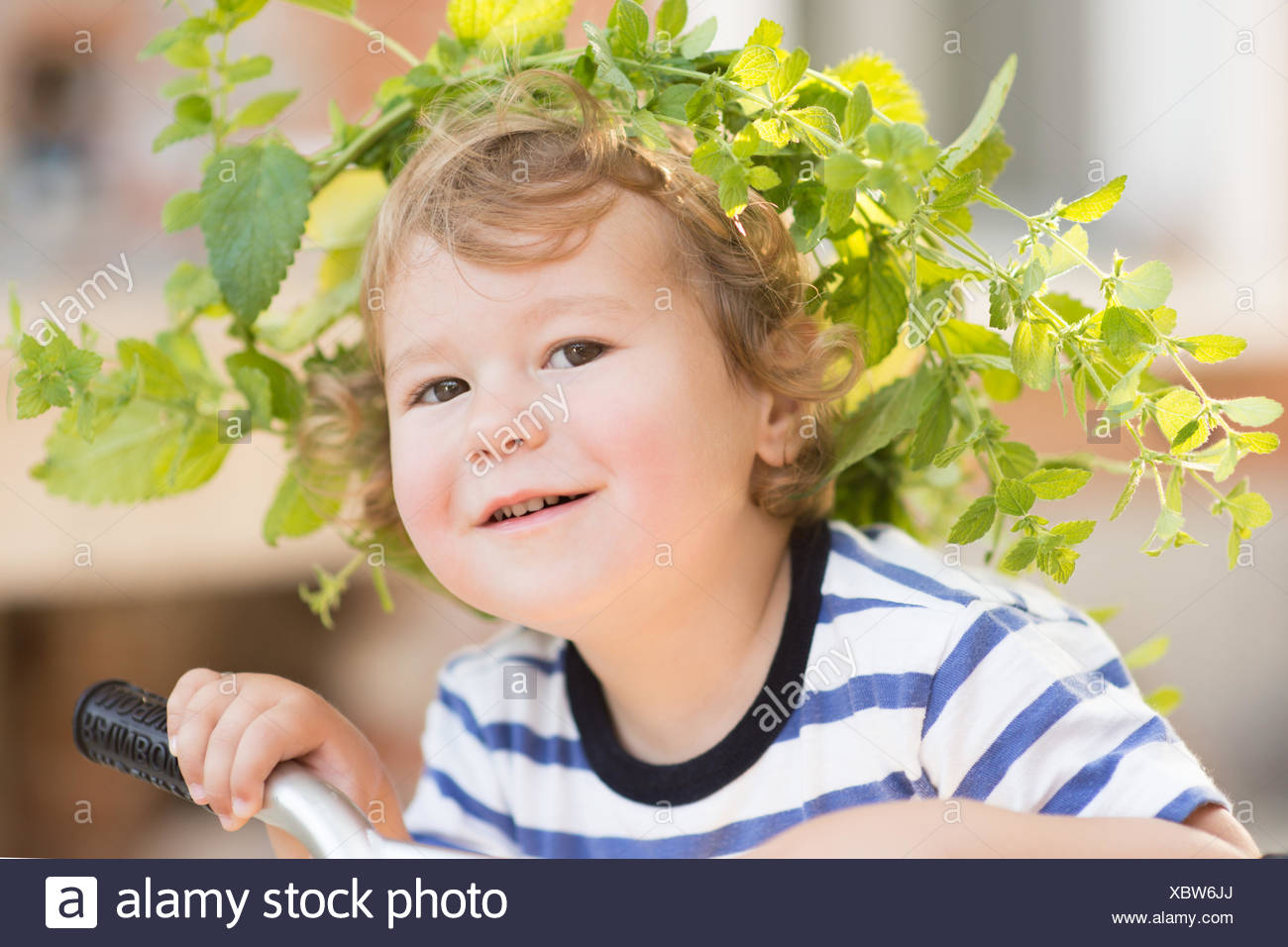 USA, South Carolina, Greenville County, Greenville, Portrait of boy (2-3) wearing wreath - Stock Image