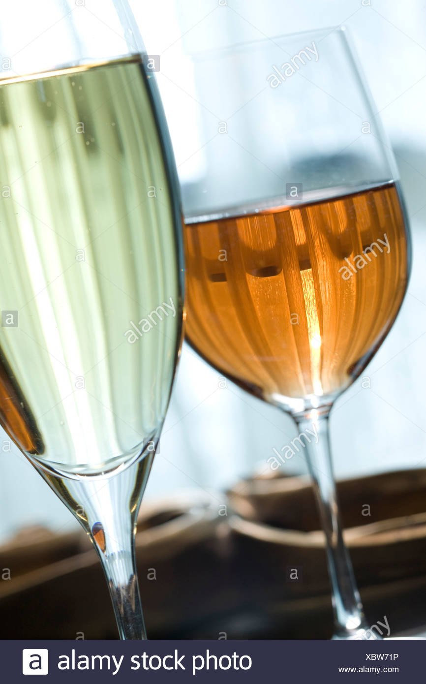 Close-up of a wine glass with a champagne flute - Stock Image