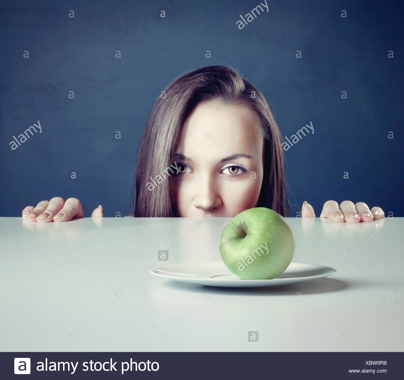 woman with apple - Stock Image
