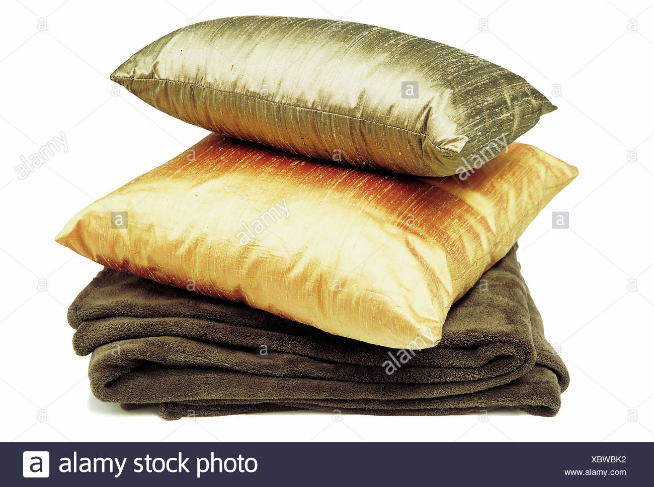 Earthy: under R Earthy colours, such as silk, and richly textured throw, look luxurious and invite you to have an early night - Stock Image