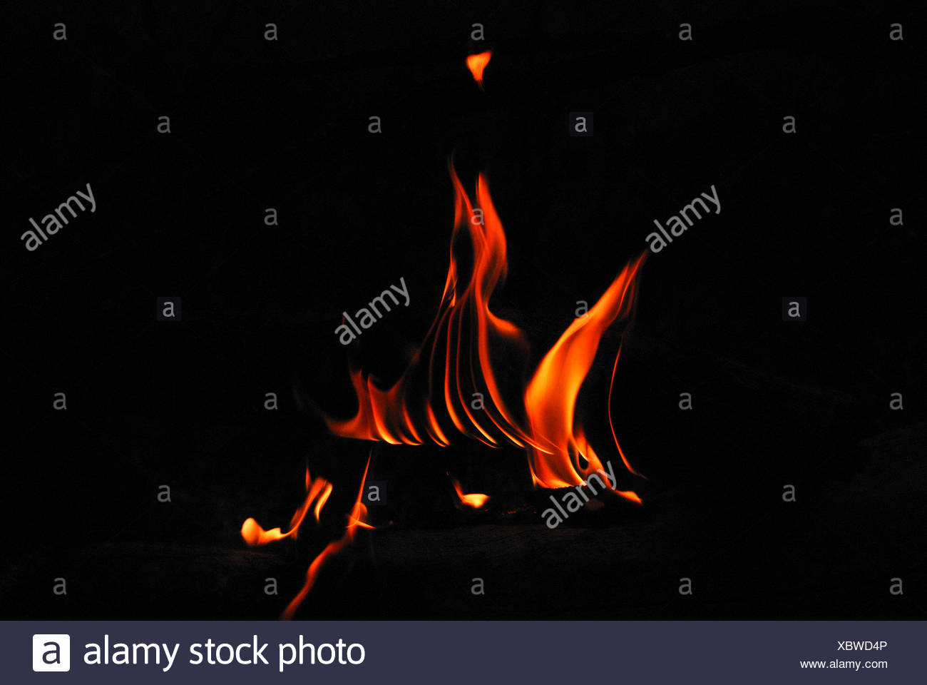 A flame is the visible (light-emitting) part of a fire at Mulshi. Stock Photo