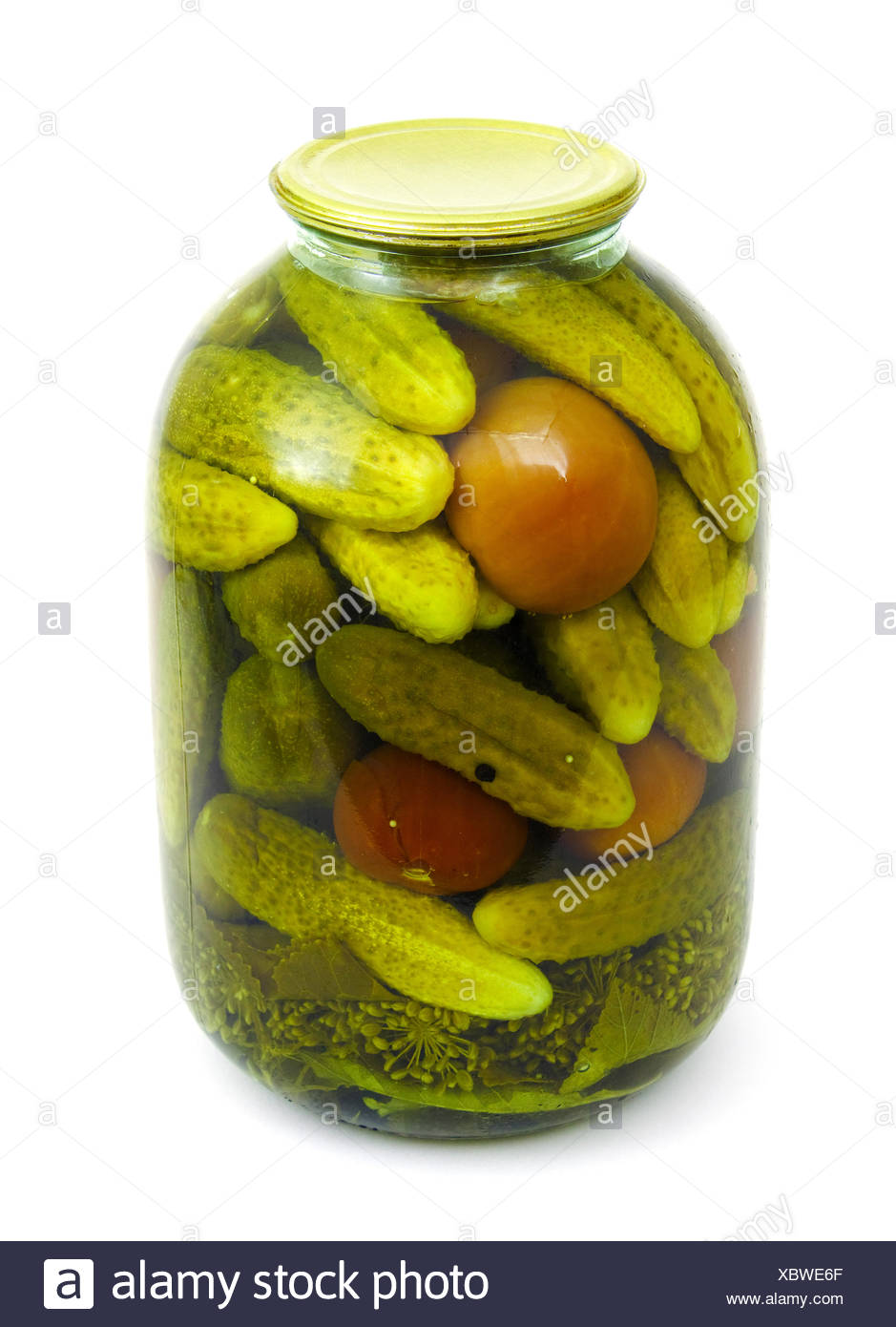 Receptacle with tinned tomatoes and cucumbers - Stock Image