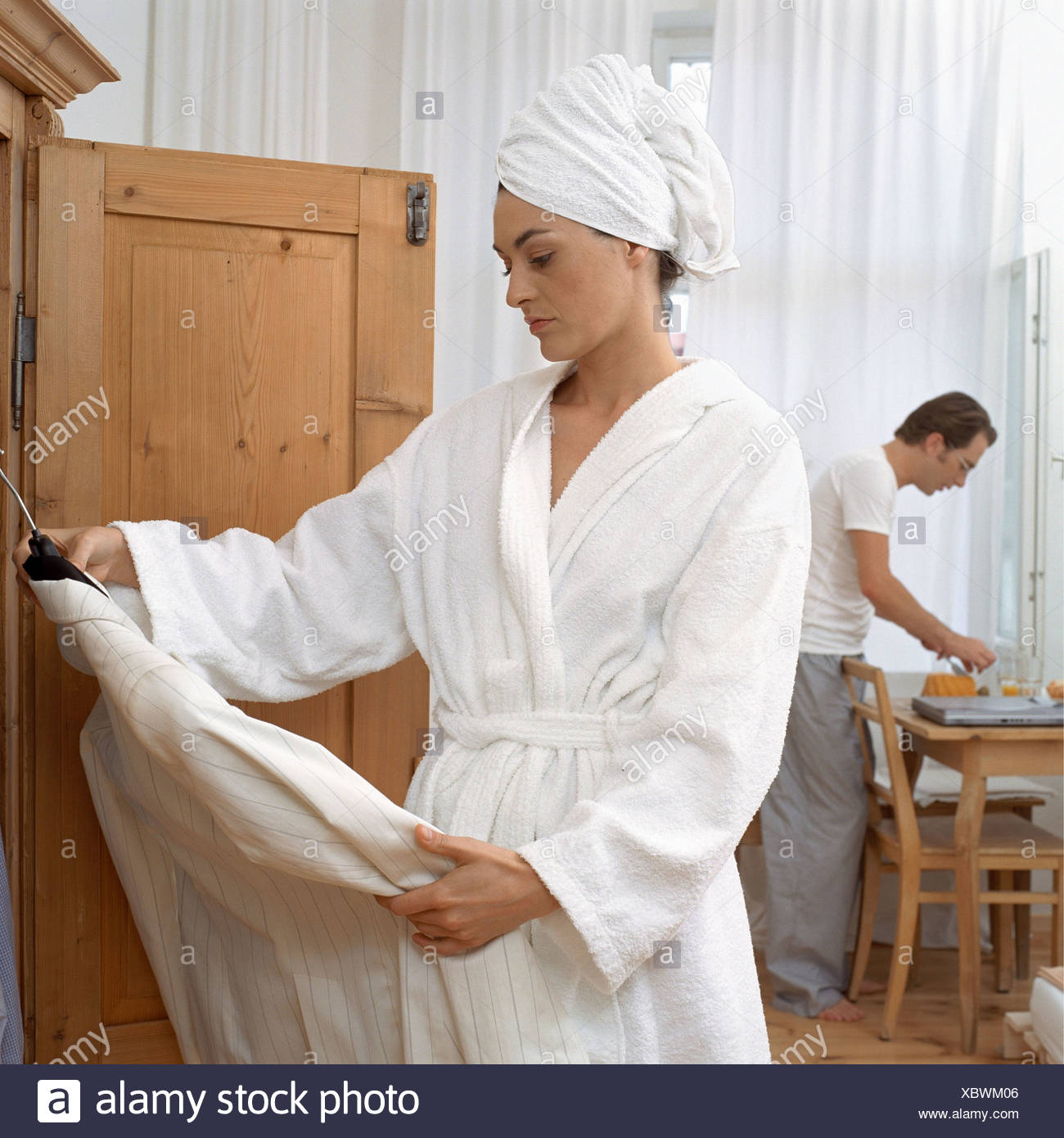 Woman deciding what to wear - Stock Image
