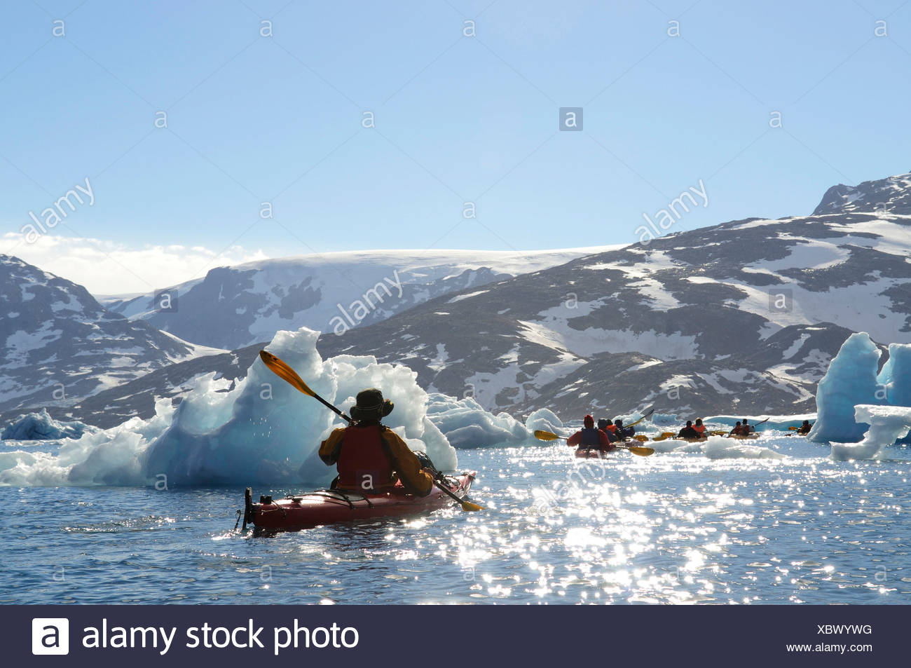 Icebergs and kayakers in the Stoklund-Fjord, East Greenland, Greenland Stock Photo