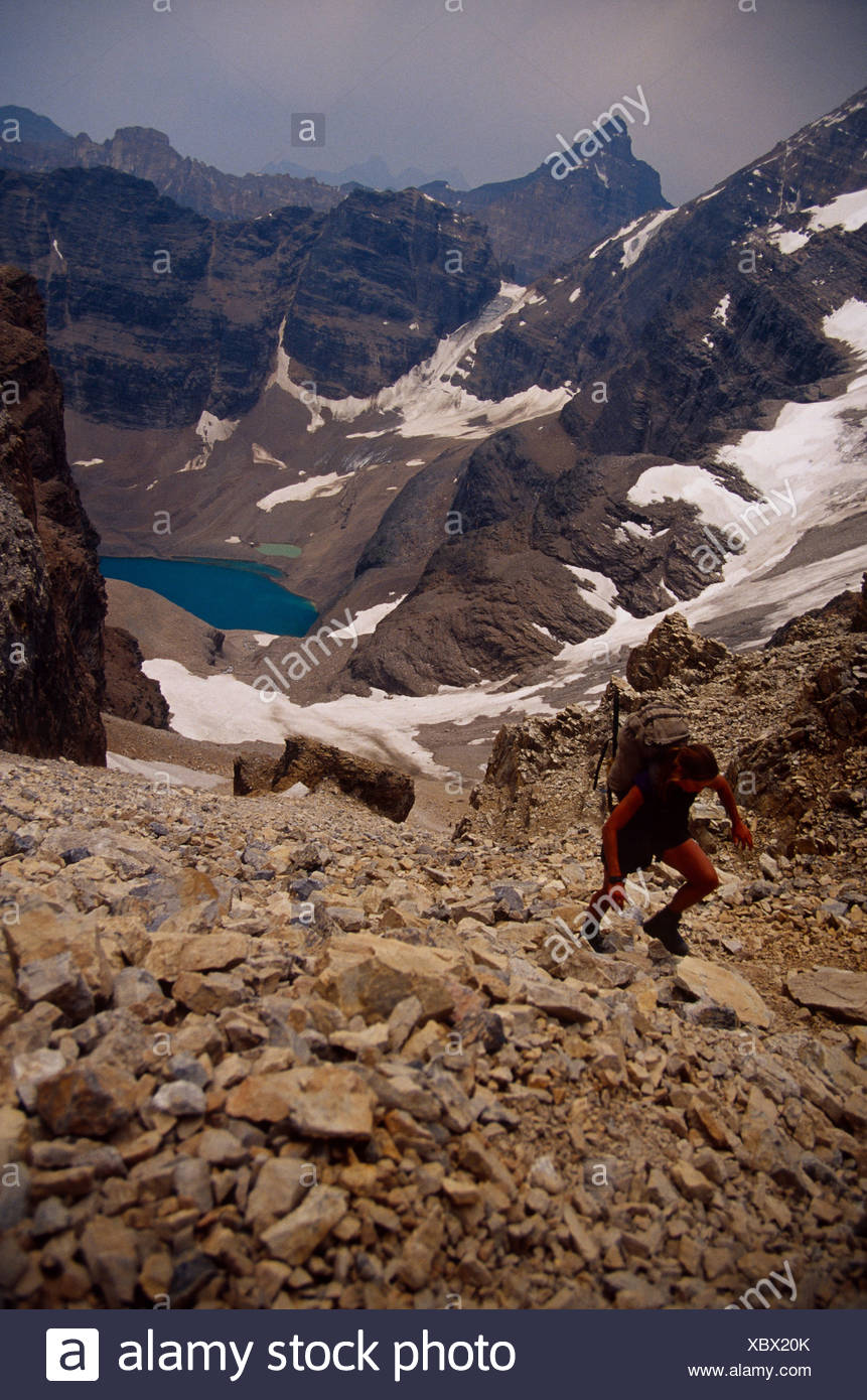 Woman hiking up talus, Canada - Stock Image