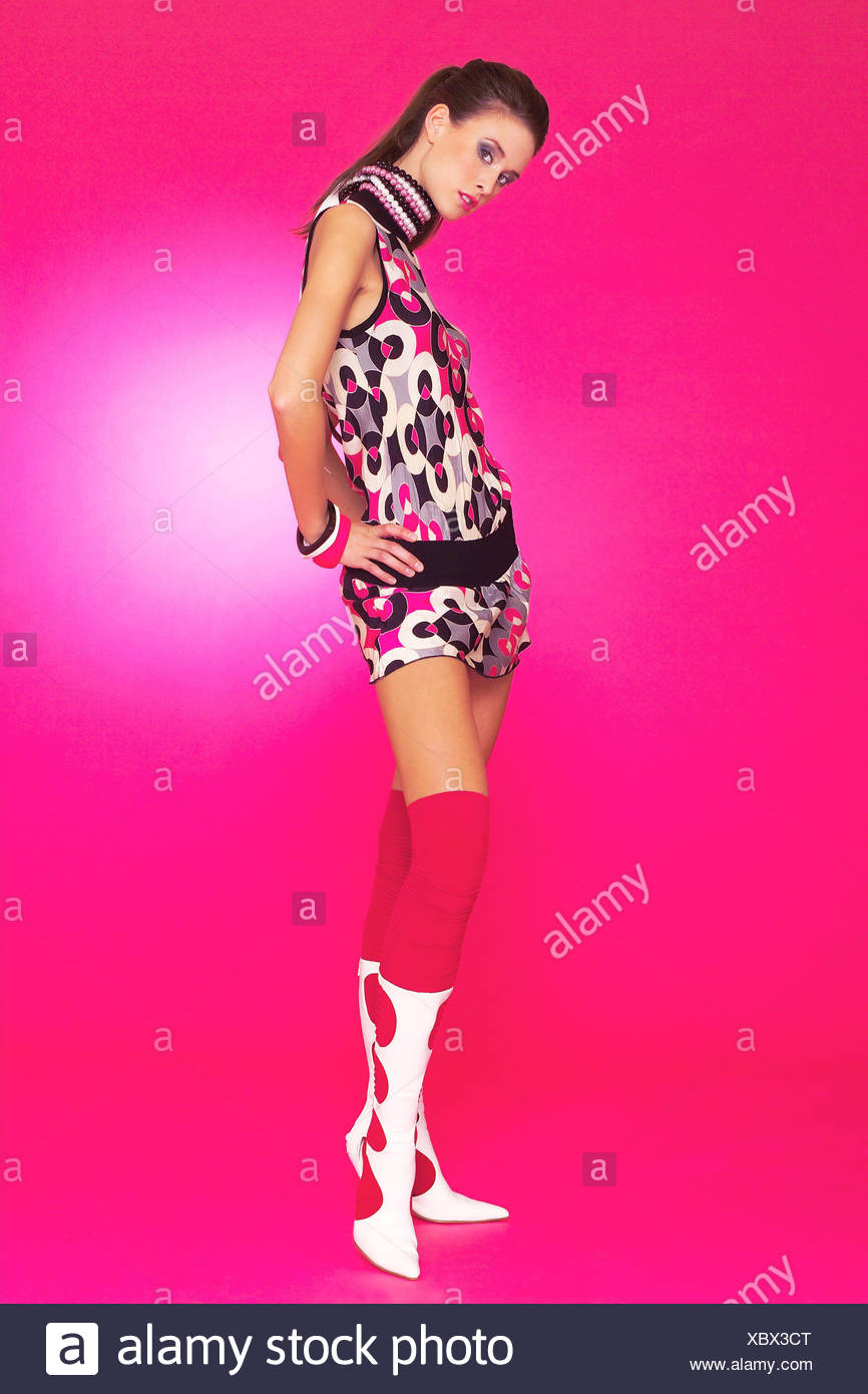 Woman, young, minidress, boot, pose, - Stock Image