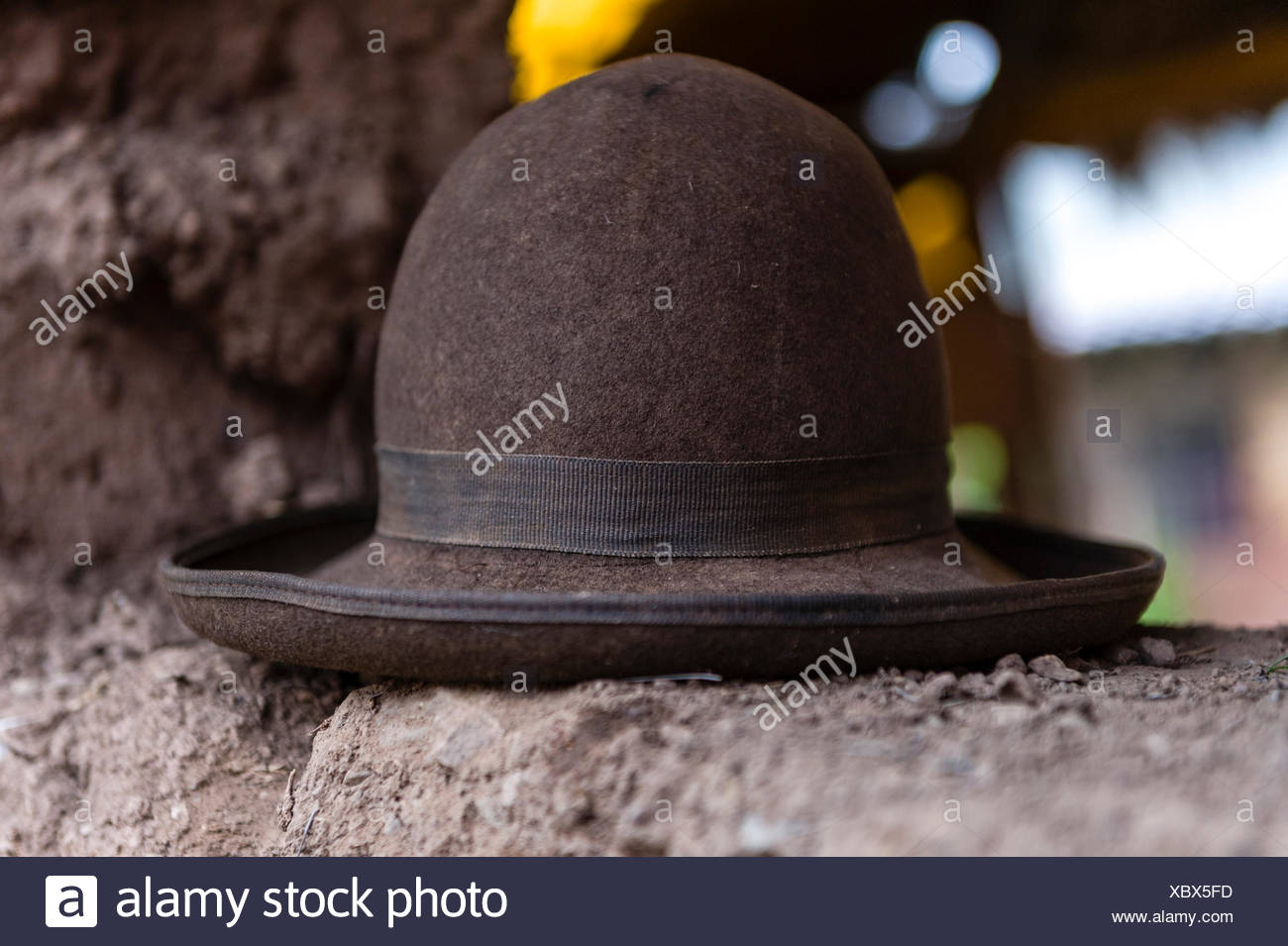 A felt Montera hat on a mud brick wall. - Stock Image