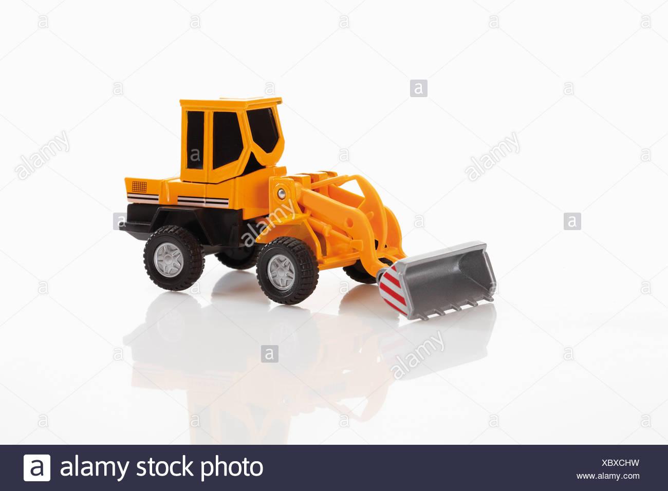 Toy bulldozer on white background - Stock Image