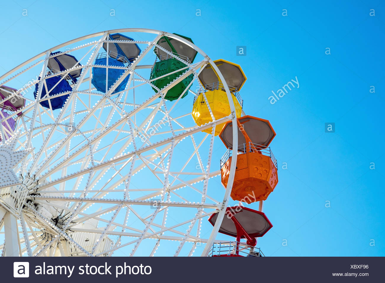 Detail of a colorful ferris wheel seen at a fair - Stock Image