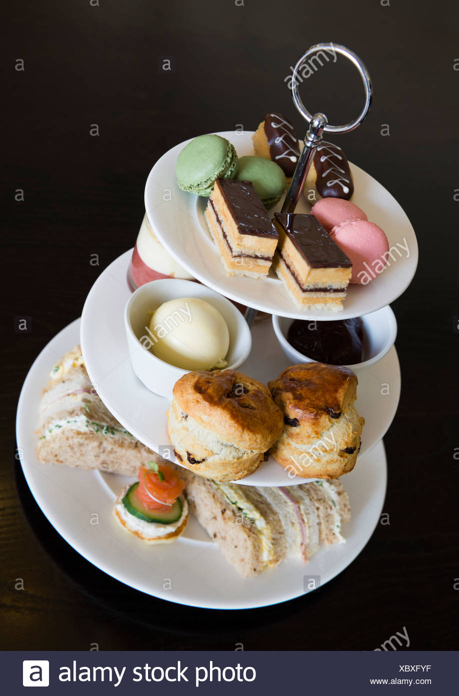 Afternoon tea with sandwiches and cakes - Stock Image