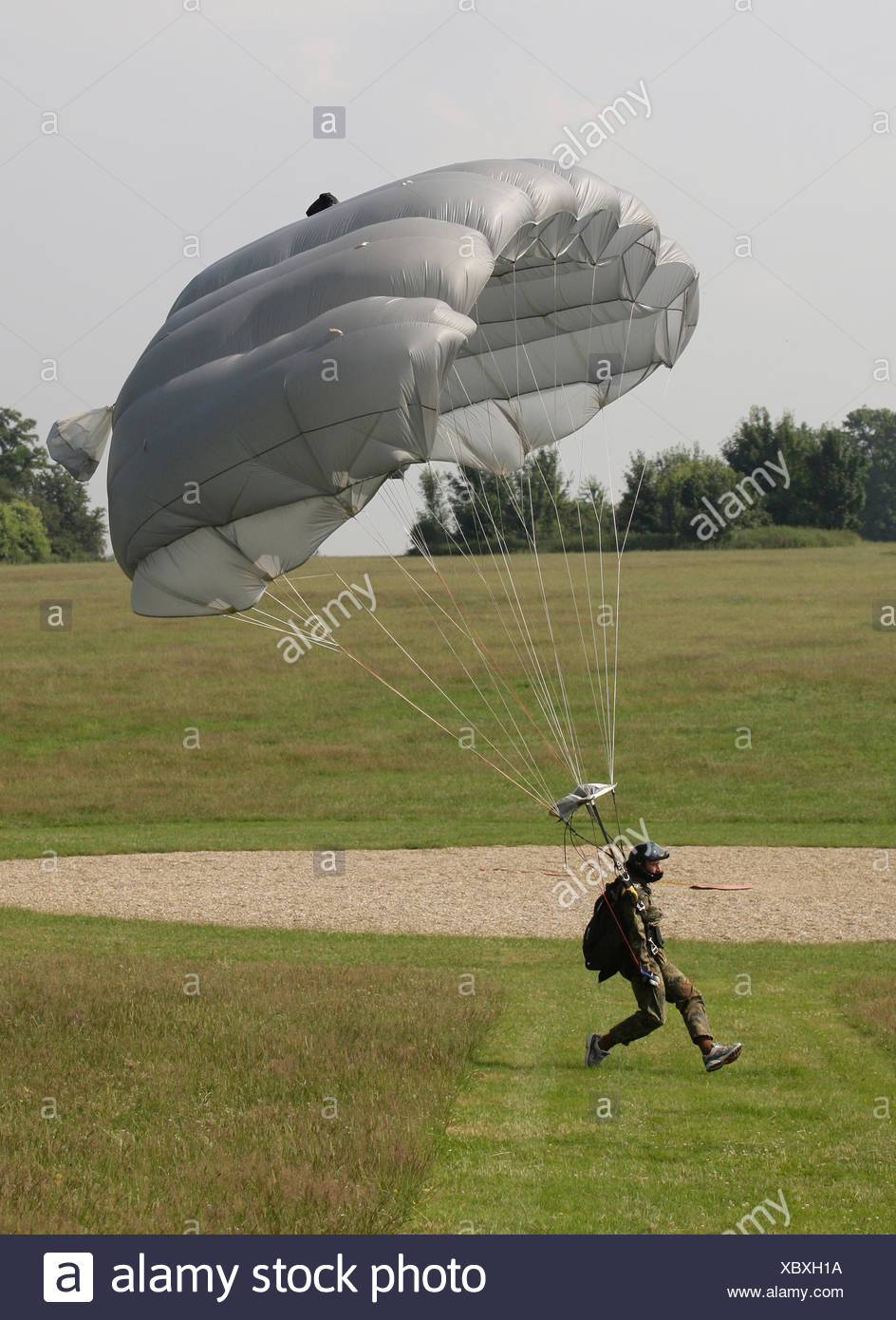 Paratrooper landing with a paraglider beside the target, 13th International Paratrooper Competition of the Special Operations Stock Photo