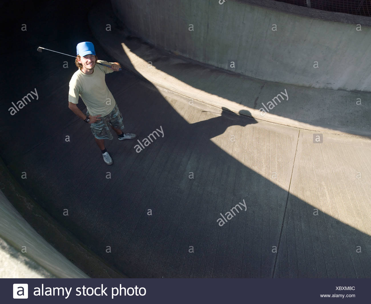 Young male urban golfer Stock Photo