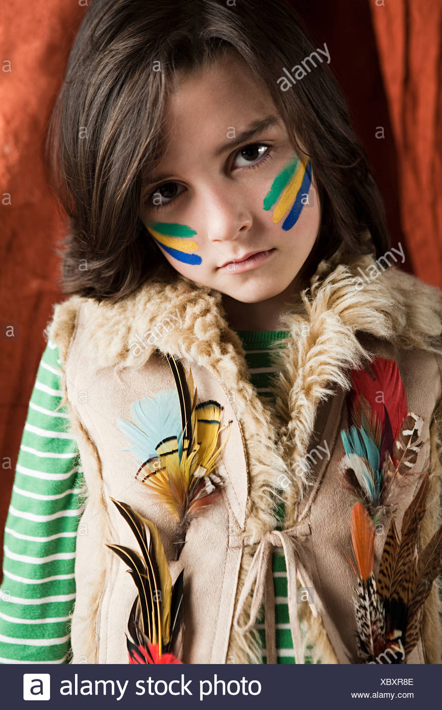 Young boy dressed up in Native American outfit - Stock Image