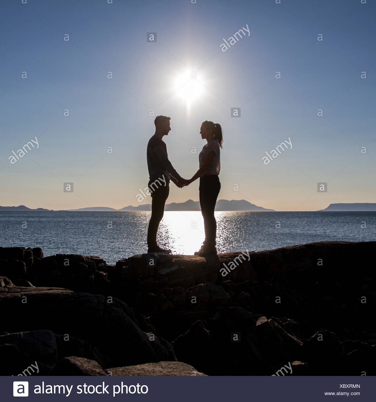 UK, Scotland, Couple on a beach holding hands - Stock Image