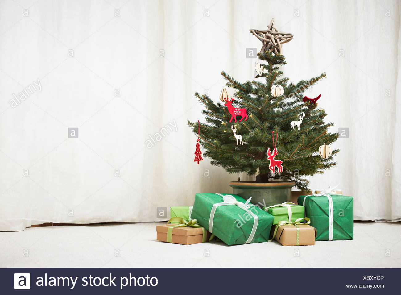 Decorated Christmas tree with gifts Stock Photo