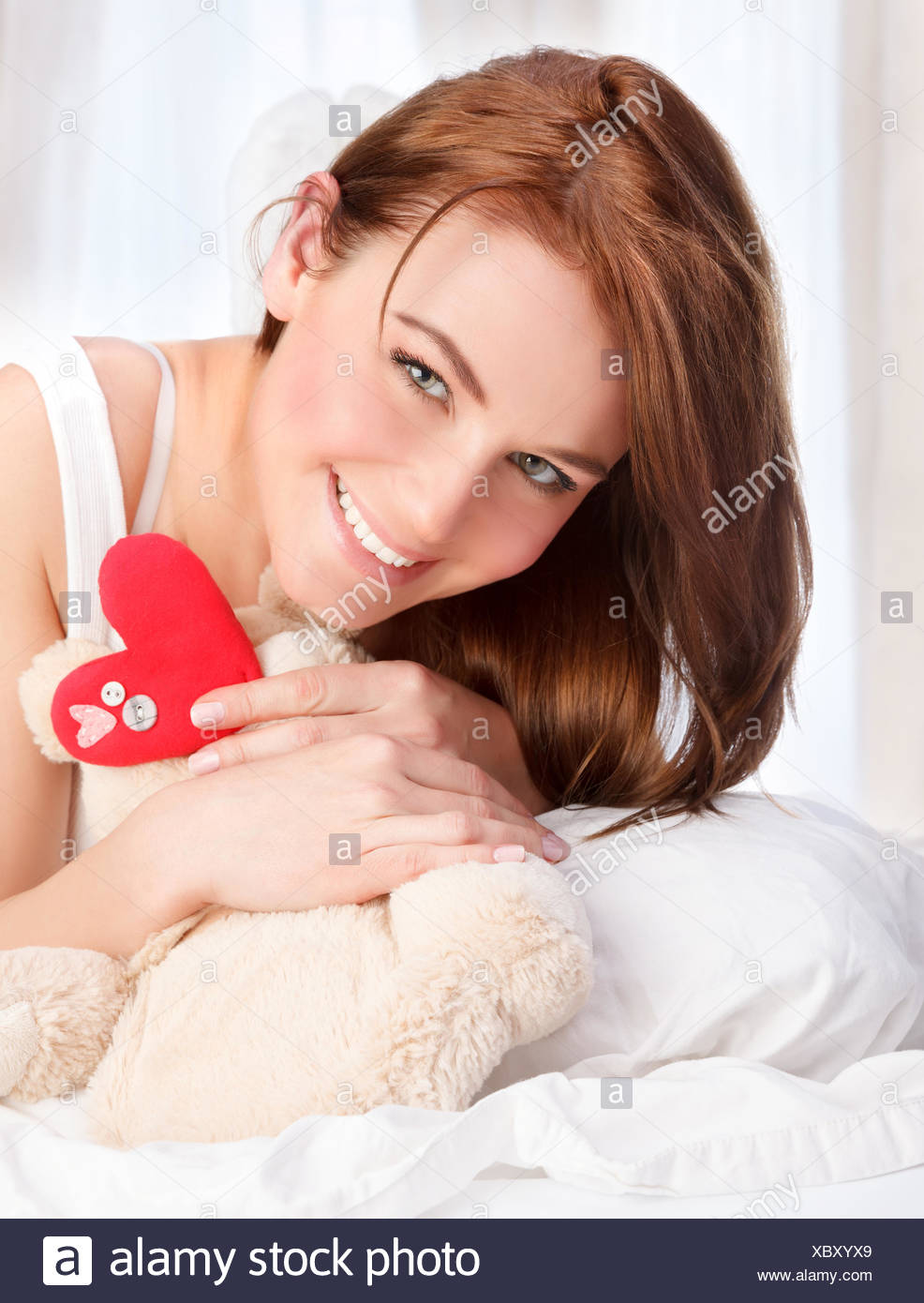 Cute girl with soft bear toy - Stock Image