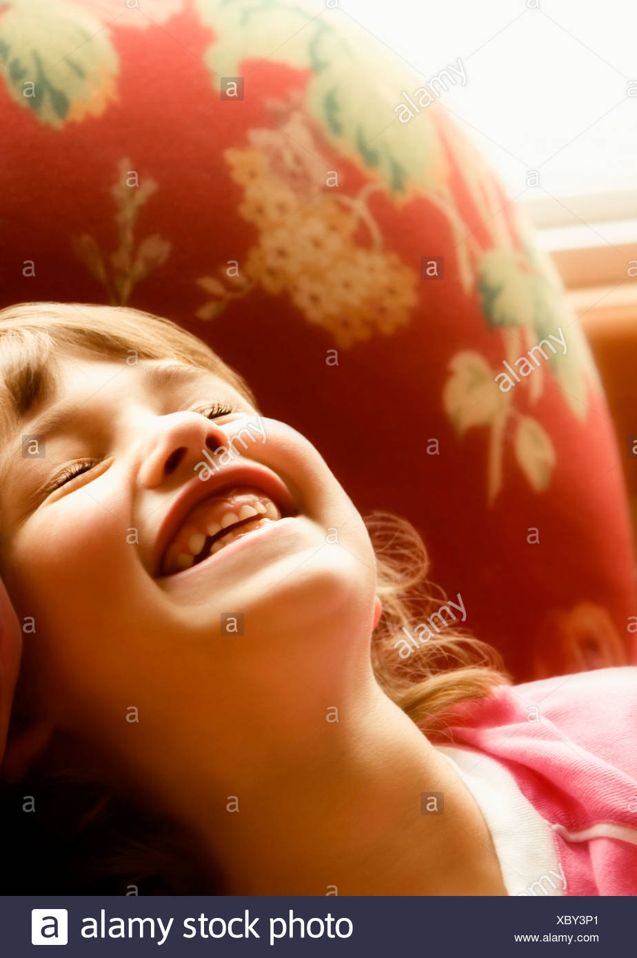Young girl laughing - Stock Image