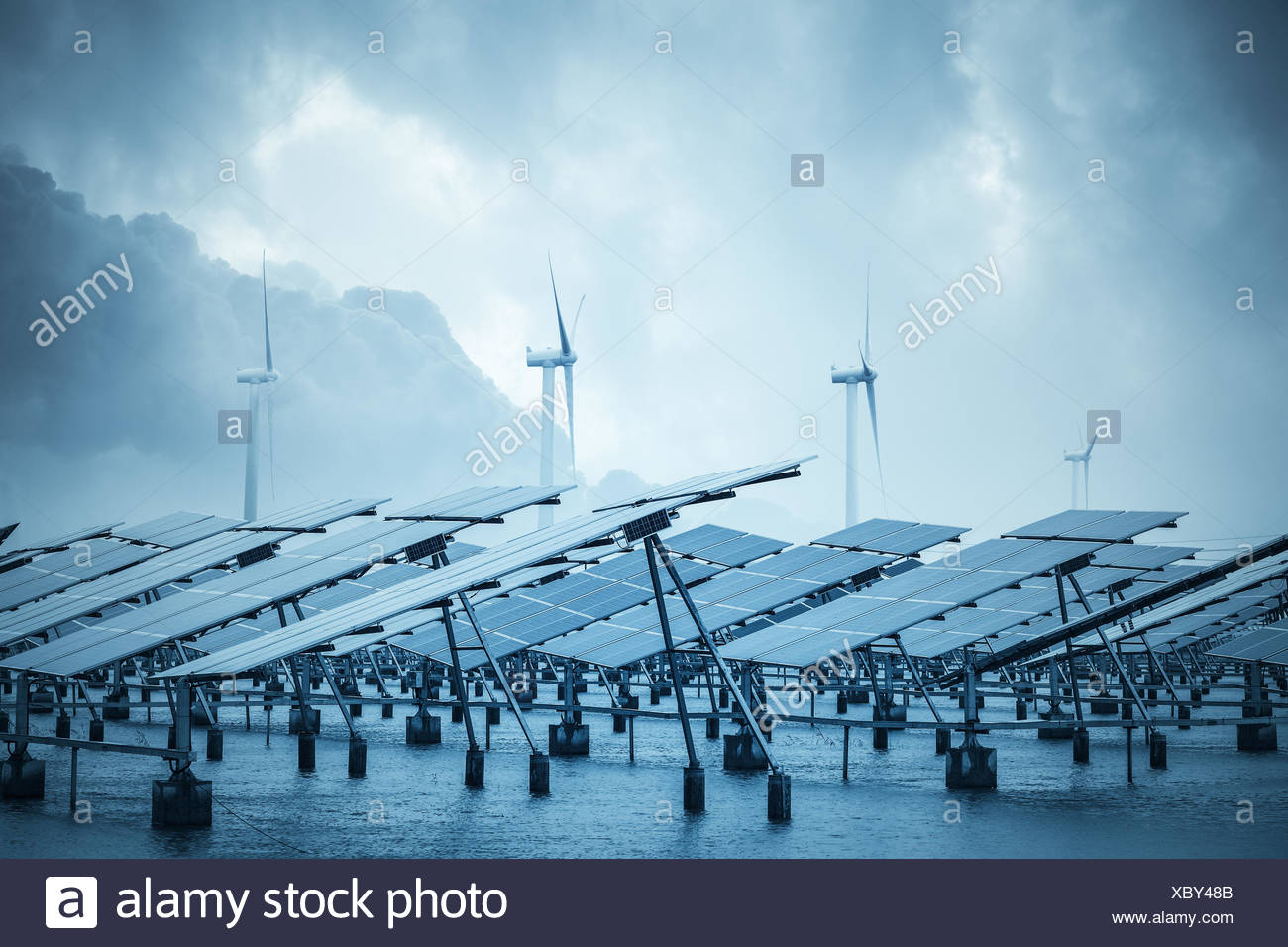 solar and wind power in coastal mud flat - Stock Image