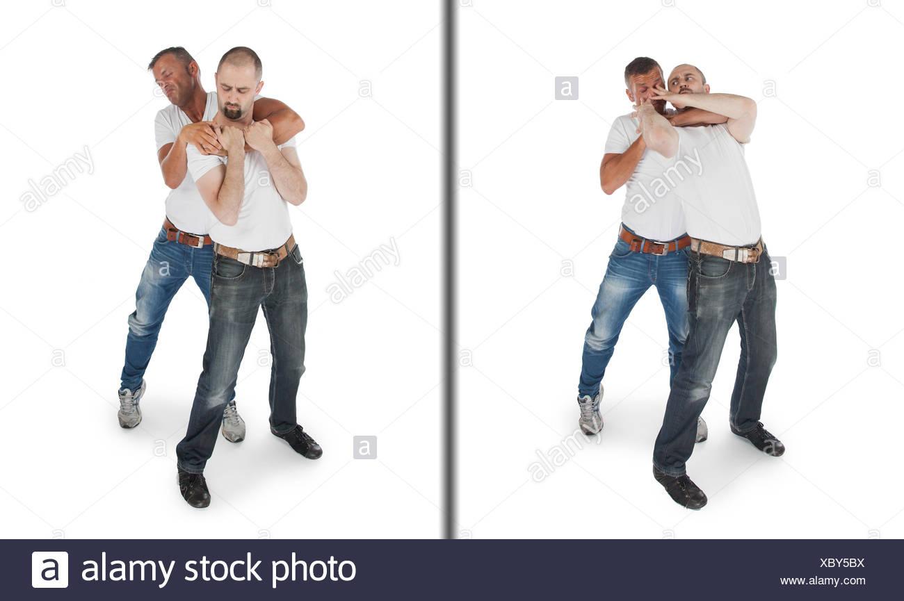 Man defending against a headlock - Stock Image