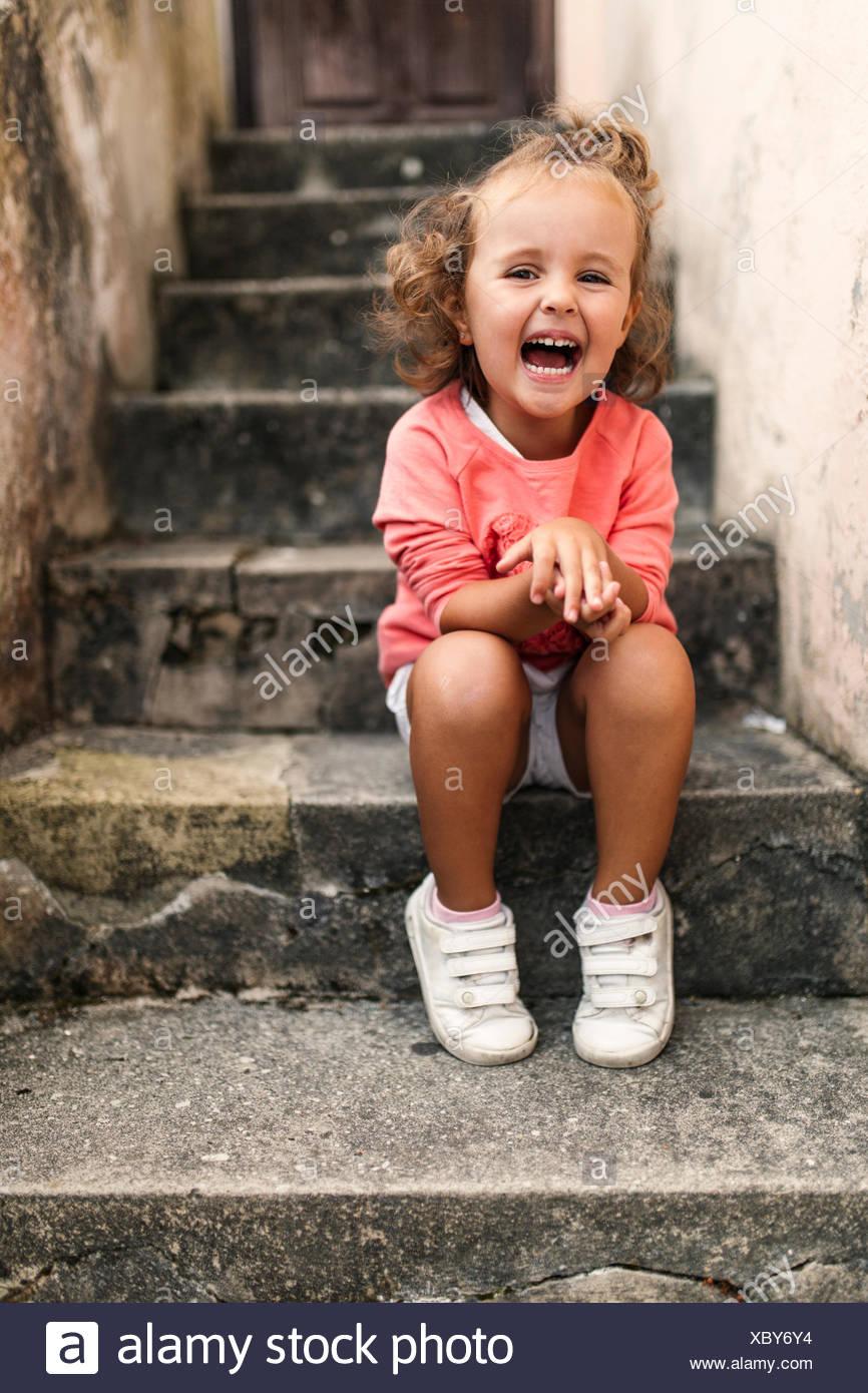 Little Girl Sitting On Steps Stock Photos & Little Girl