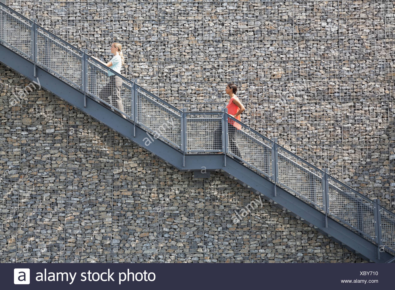 Side View Of Businesswomen Climbing Staircase   Stock Image