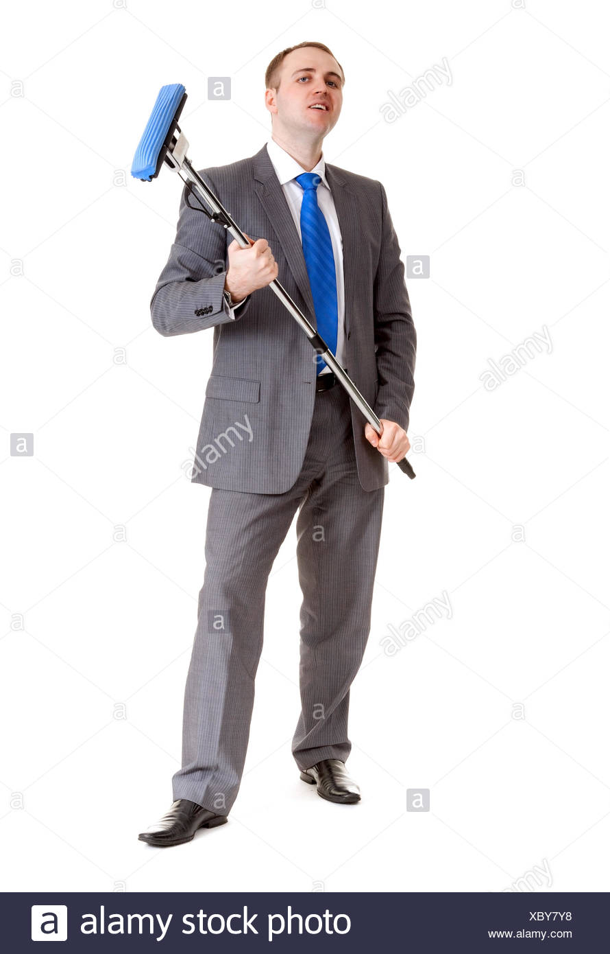 Businessman with a mop - Stock Image