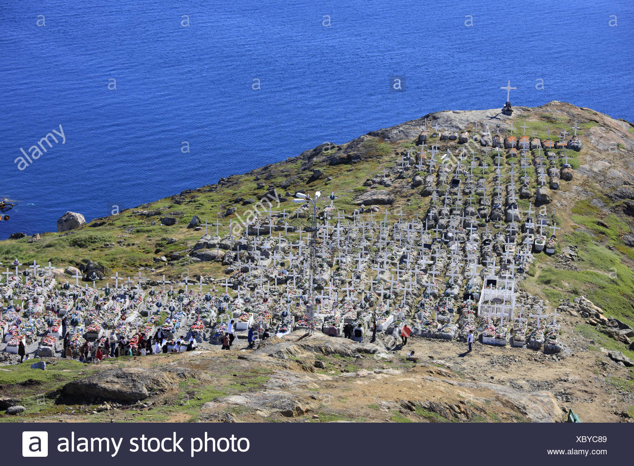 Greenland, Upernavik, bile coast, cemetery, view, sea, North-Western Greenland, coast, coastal scenery, water, the Arctic, tombs, crosses, faith, religion, Christianity, death, hope, grief, person, relatives, visitors, - Stock Image