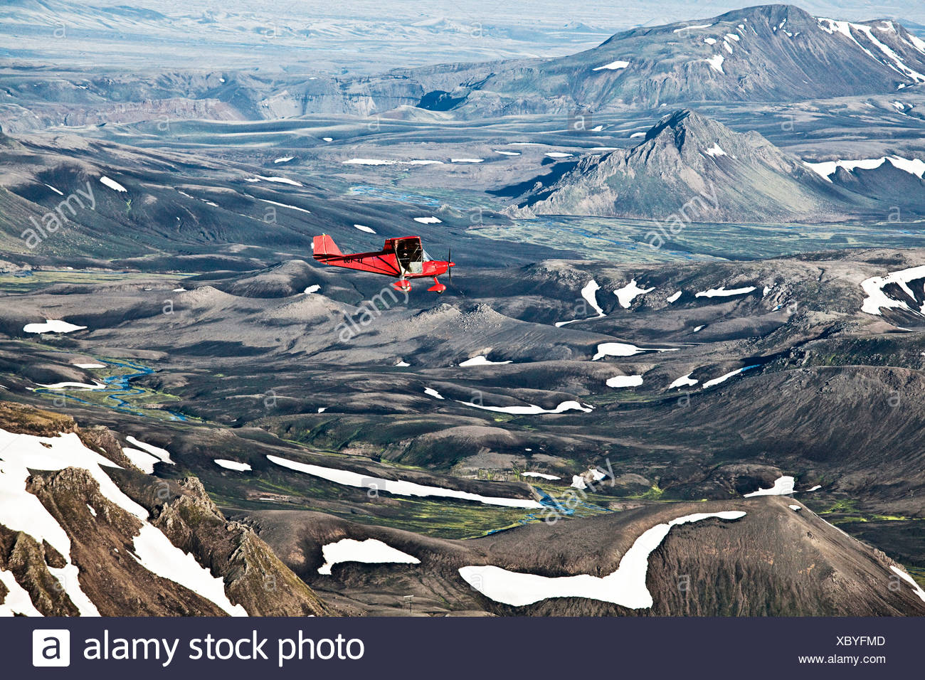 Aerial view, a red single-engine lightweight airplane flying over the volcanoes, Highlands of Iceland, Iceland, Europe - Stock Image