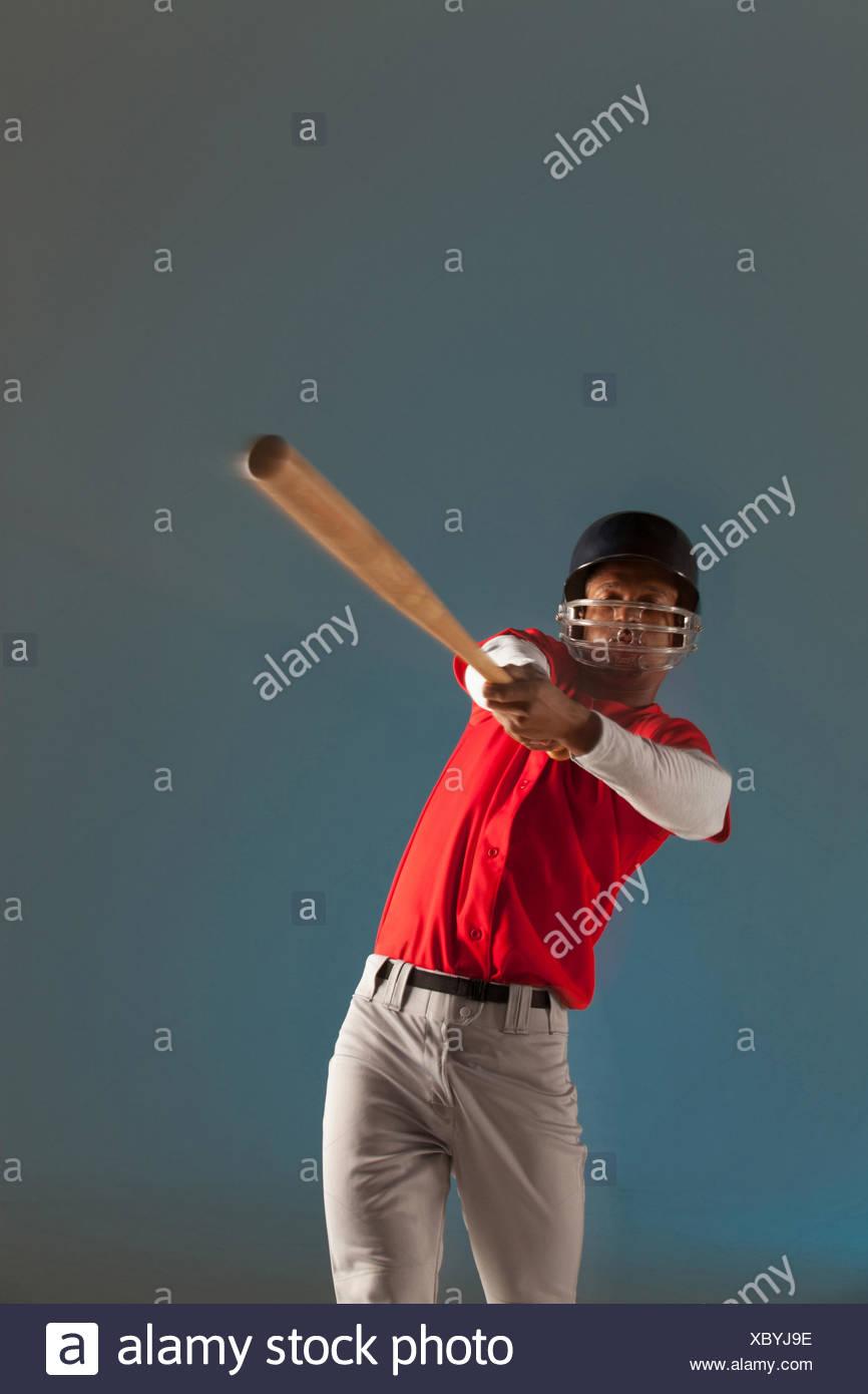 Blurred view of baseball player swinging bat - Stock Image