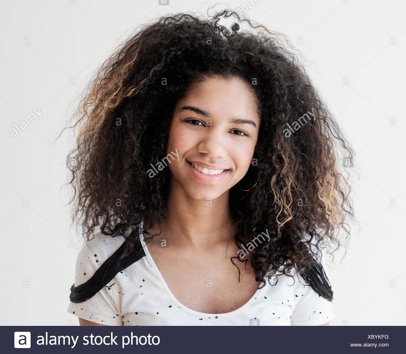 Portrait of teenage girl (16-17) on white background - Stock Image