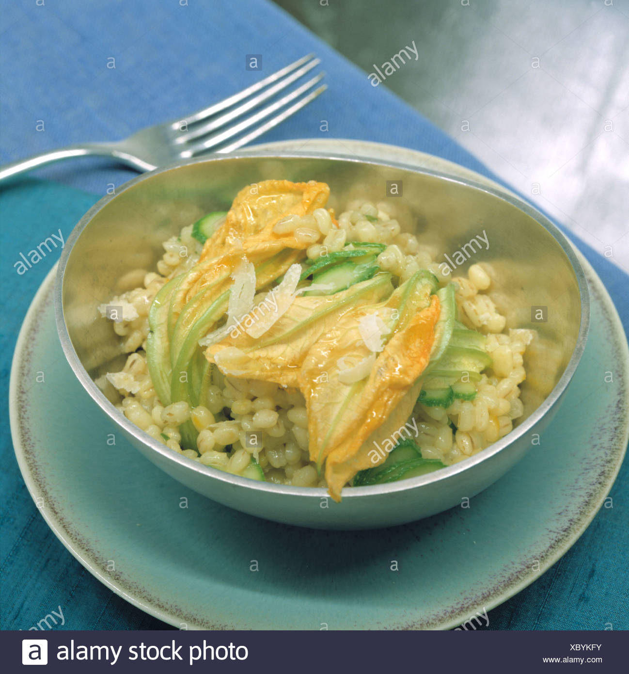 Groat - risotto with courgette blossoms - Stock Image