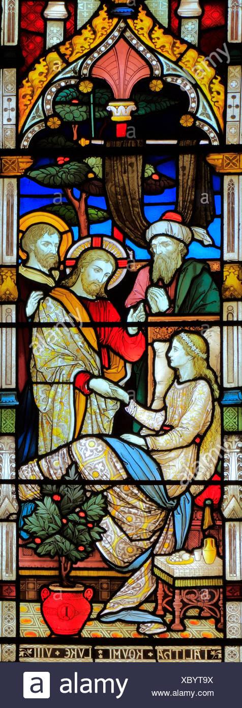 Miracles of Jesus, Raising of Jarius' daughter, Talitha Koum, stained glass window, by Heaton Butler & Bayne, 1878, Swaffham, Norfolk, England, UK - Stock Image