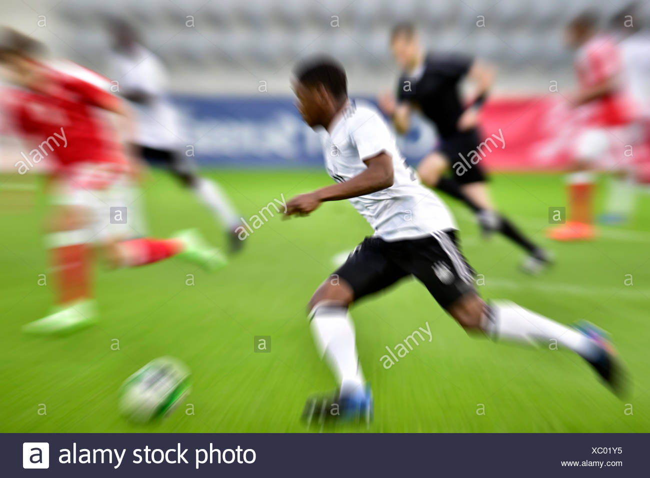 Football game, football player in motion, Biel, Switzerland - Stock Image
