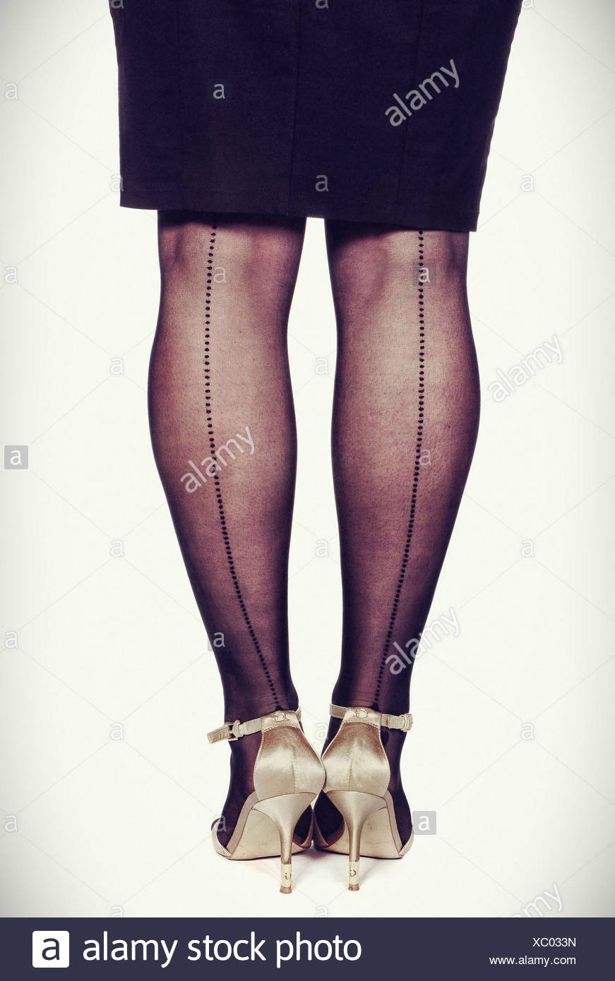 women's legs, skirt, black, nylon tights - Stock Image