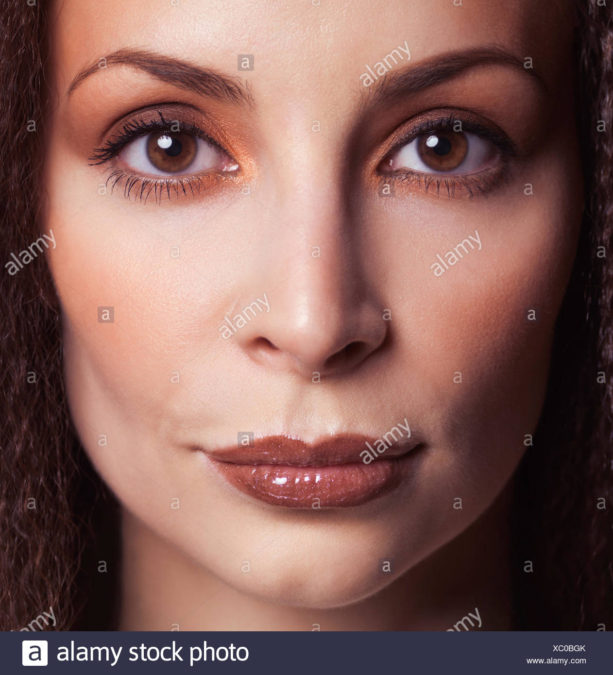 Woman's face wearing makeup Stock Photo