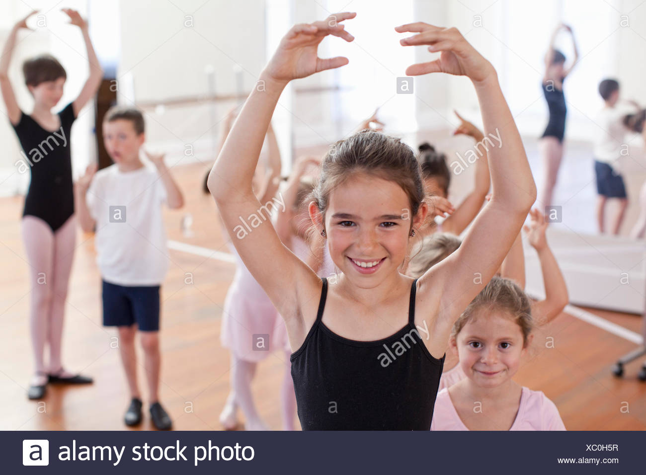 Portrait of girl ballet dancing in ballet school - Stock Image