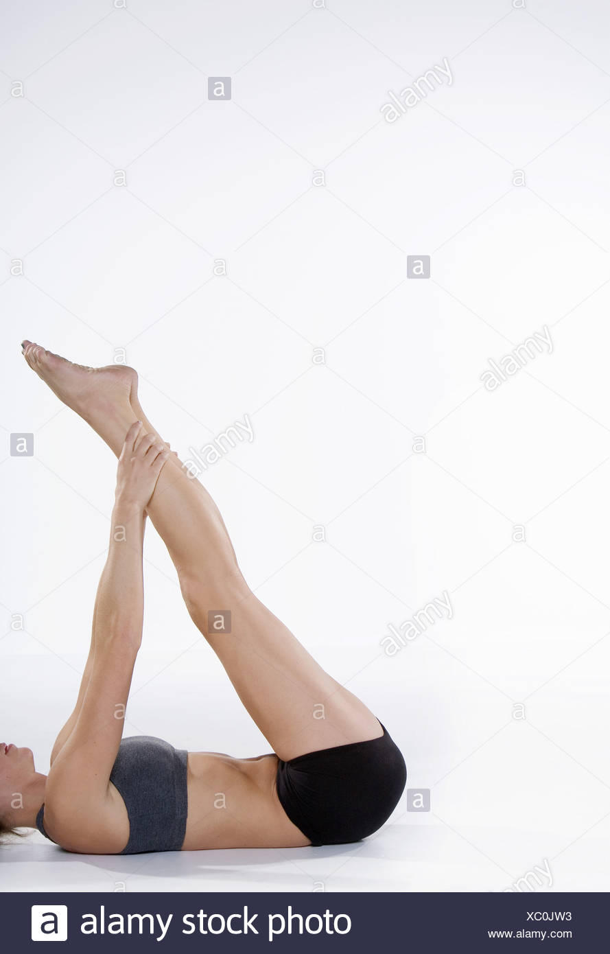 Woman in athletic gear stretching Stock Photo