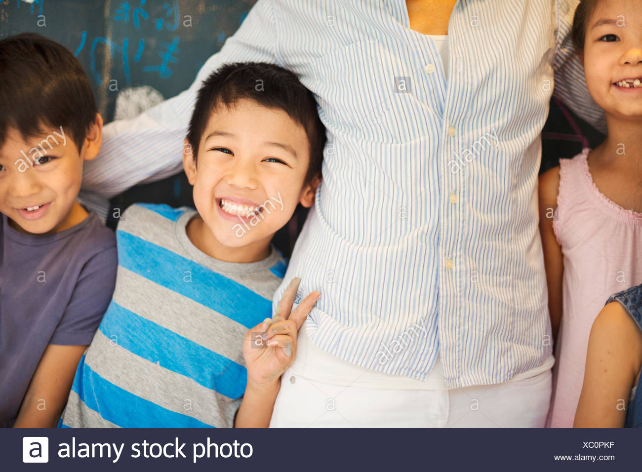 A group of children in school with their teacher. Stock Photo