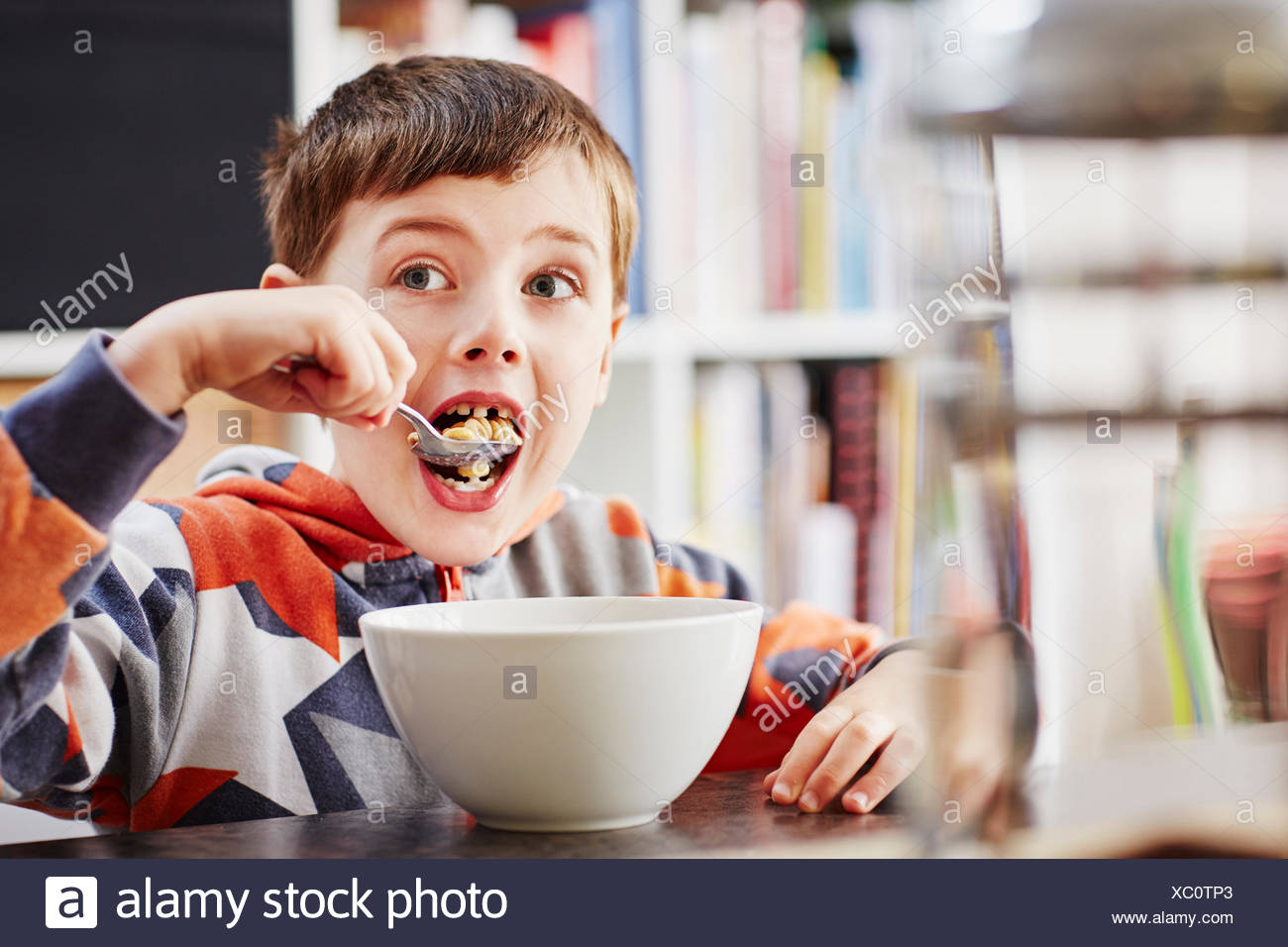 Young boy eating breakfast - Stock Image