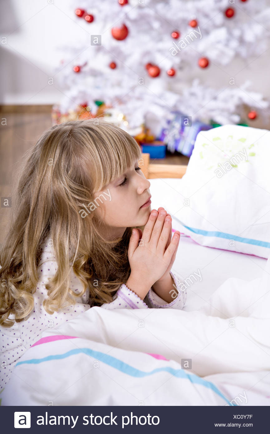 xmas praying Stock Photo